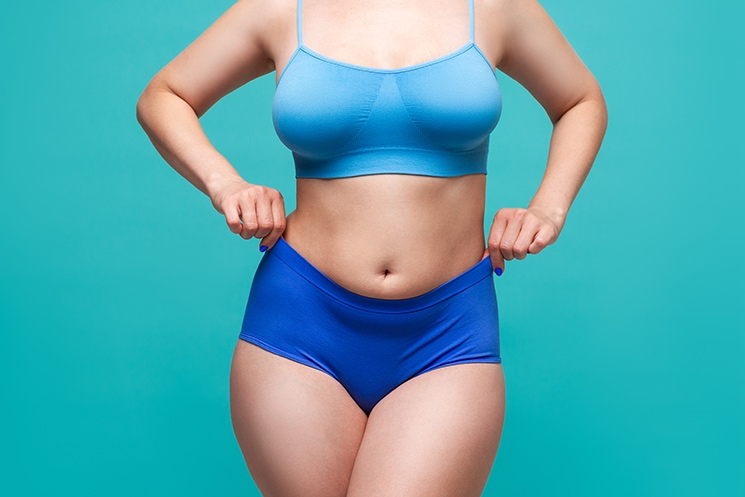 Plus,Size,Model,In,Blue,Underwear,On,Turquoise,Background,,Body